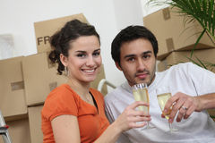 Couple celebrating purchase of  house Royalty Free Stock Photography
