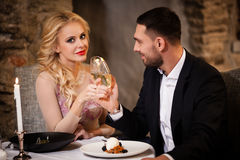 Couple celebrating in restaurant Royalty Free Stock Image