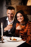 Couple celebrating in restaurant Royalty Free Stock Photo