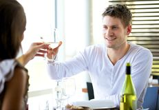 Couple Celebrating Something at a Restaurant. Portait of a couple celebrating something at a restaurant Royalty Free Stock Images