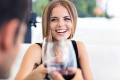 Couple celebrating something in restaurant. Happy couple celebrating something in restaurant with red wine Stock Photo