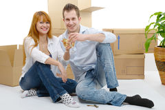 Couple celebrating their new home,  and champagne in hand. Stock Images