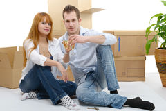 Couple celebrating their new home, keys and champagne in hand. Royalty Free Stock Photography