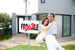 Couple celebrating their new house Stock Images