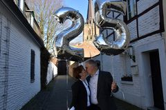 Couple celebrating their 25th marriage anniversary