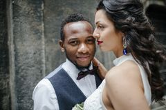 Couple celebrating their wedding day. Beautiful wedding couple celebrating their wedding day ,happy african american groom and caucasian bride Royalty Free Stock Images