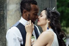 Couple celebrating their wedding day. Beautiful wedding couple celebrating their wedding day ,happy african american groom and caucasian bride Stock Photography