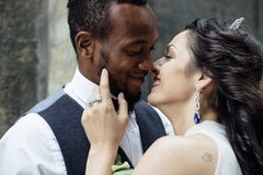 Couple celebrating their wedding day. Beautiful wedding couple celebrating their wedding day ,happy african american groom and caucasian bride Stock Image