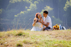 Couple celebrating together at picnic Stock Images