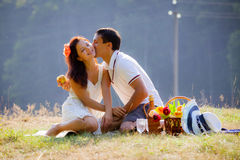 Couple celebrating together at picnic royalty free stock image