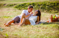 Couple celebrating together at picnic stock photography