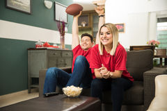 Couple celebrating a touchdown Royalty Free Stock Images