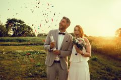 Celebrating wedding day. Couple celebrating wedding day outdoors stock photo