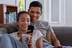 Couple cellphone couch Stock Photography