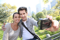 Couple in central park taking selfie Stock Photos