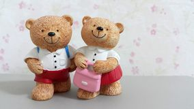 Couple of ceramic bear dolls go to school Stock Photos