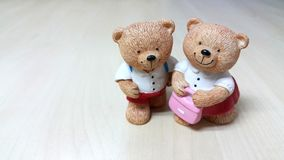 Couple of ceramic bear dolls go to school Royalty Free Stock Image