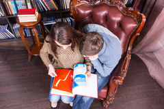 Couple on a Chair Holding a Book in Aerial View Royalty Free Stock Photos
