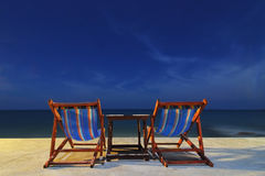 A couple of chairs. On the beack in night sky Stock Photo