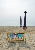 Couple of chairs on beach Stock Image