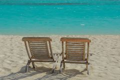 Couple of chairs on the beautiful beach at the tropical island at resort. At Maldives Stock Photography