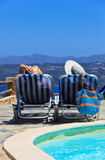 Couple on chairs at sea vacation Stock Photography