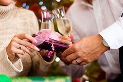 Couple with champagne on Christmas Eve Stock Photography