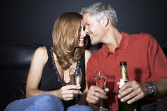 Couple With Champagne Flutes Rubbing Noses Stock Image