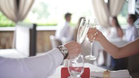 Couple with champagne glasses dating and toasting in restaurant.  stock video footage
