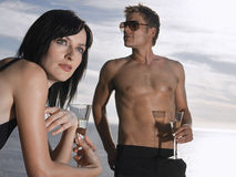 Couple With Champagne Glasses By Sea Stock Photos