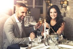 Couple celebrating in restaurant Stock Photo