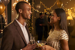 Couple Chat As They Enjoy Cocktail Party Together Royalty Free Stock Photos