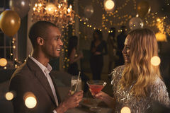 Couple Chat As They Enjoy Cocktail Party Together Stock Photo