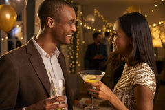 Couple Chat As They Enjoy Cocktail Party Together Stock Photography