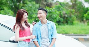 Couple chatting happliy by car royalty free stock images