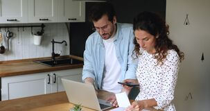 Couple check bills count expenses feels concerned due financial debt