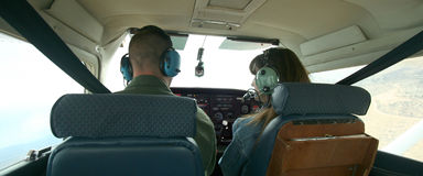 A Couple Check the Gauges. A Couple Check Gauges as They Pilot a Small Plane Together Stock Photo