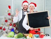 Couple check list ingredients for christmas dinner. Menu for our family. Cooking christmas meal. Man and woman chef. Couple check list ingredients for christmas stock images