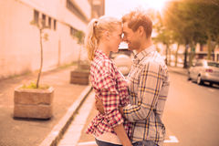 Couple in check shirts and denim hugging each other Royalty Free Stock Photos