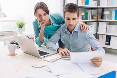 Couple checking bills at home Royalty Free Stock Photography