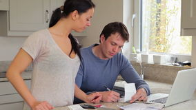 Couple checking bills with the laptop Stock Photo