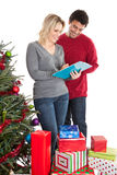 Couple checking Christmas list Stock Photography