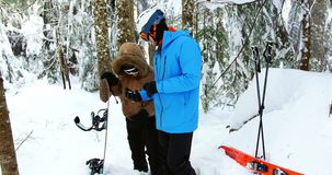 Couple checking direction on compass 4k. Couple checking direction on compass in snow 4k stock footage