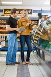 Couple Checking Ingredients Of Product At Royalty Free Stock Images