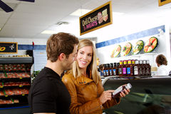 Couple checking labels. In butcher shop Royalty Free Stock Photos