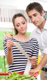 Couple checking a long supermarket receipt Royalty Free Stock Photo