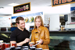 Couple checking out cheeses Royalty Free Stock Photos