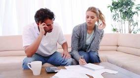 Couple checking their bills Stock Photos