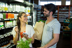 Couple checking their notepad while shopping in organic section Royalty Free Stock Photo