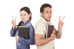 Couple of cheerful happy attractive students holding book Stock Images